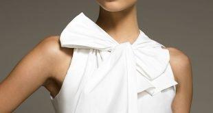 белая блуза с бантом без рукавов