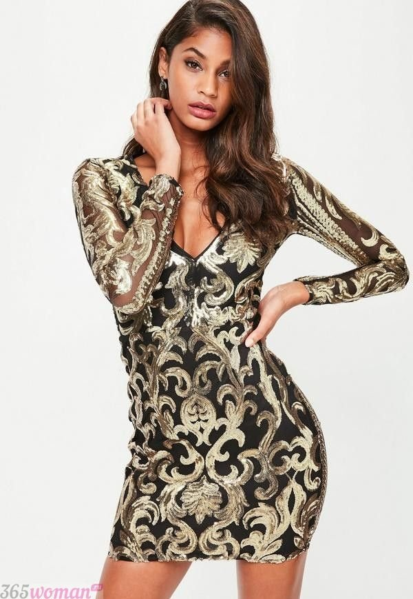 Что одеть на новогодний корпоратив: короткое платье золотого цвета с черным узором