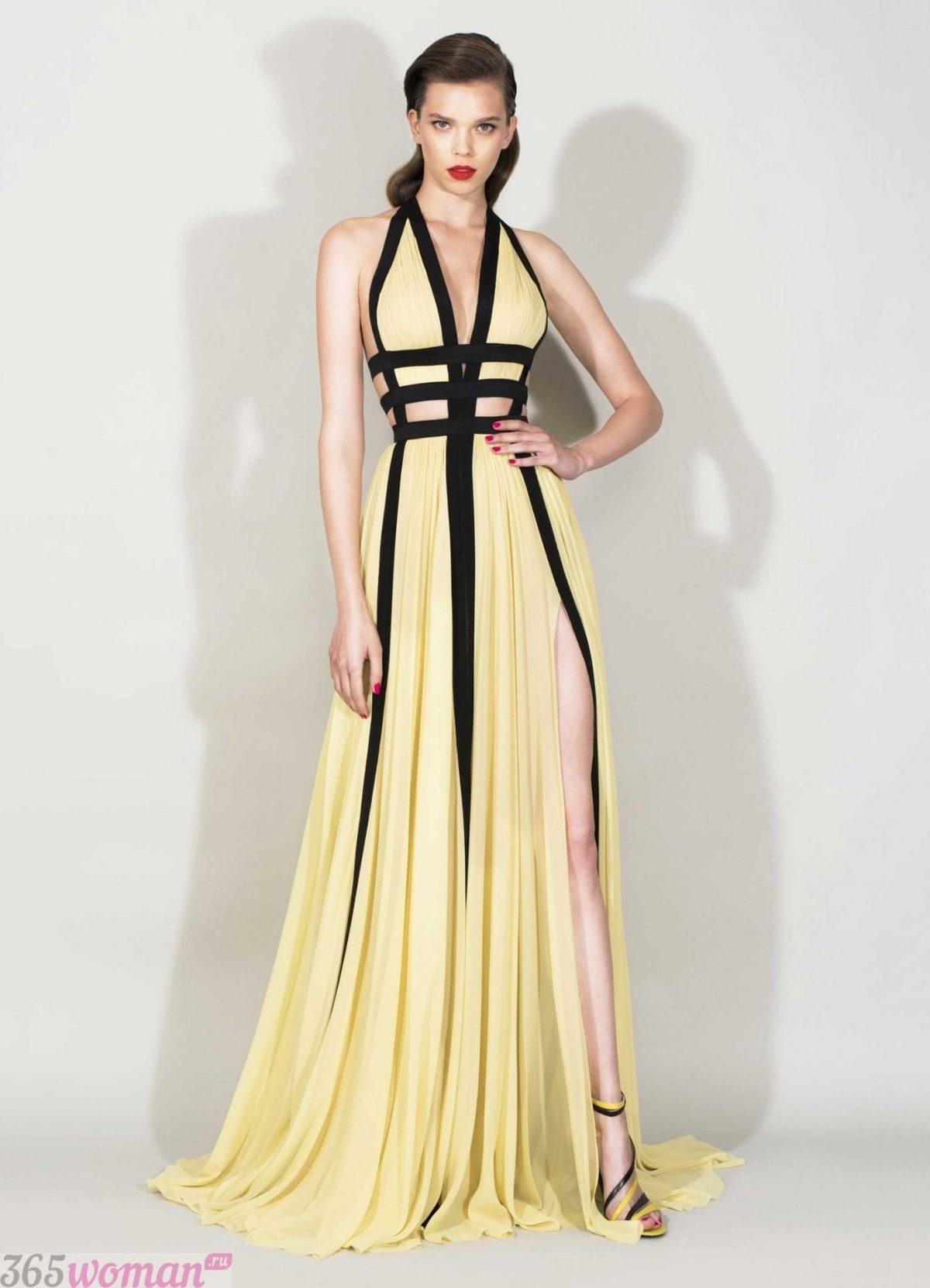 в каком цвете встречать новый год: платье желтого оттенка с черными элементами